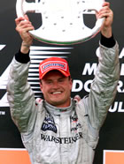 David Coulthard(McLaren) / Holding his trophy