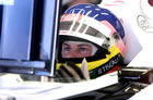 Jacques Villeneuve - BAR / Sitting in car with helmet looking at monitor in Friday Practice