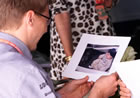Mika H�kkinen(McLaren) / Looking at a photo of his son Hugo
