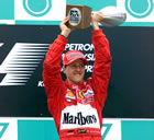 Michael Schumacher (Ferrari) / Michael with the trophy