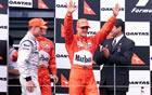 Michael Schumacher - Ferrari, David Coulthard - McLaren & Rubens Barrichello - Ferrari / Sunday Race Podium
