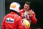 Michael Schumacher (Ferrari) and Rubens Barrichello (Ferrari) / Talking after the race